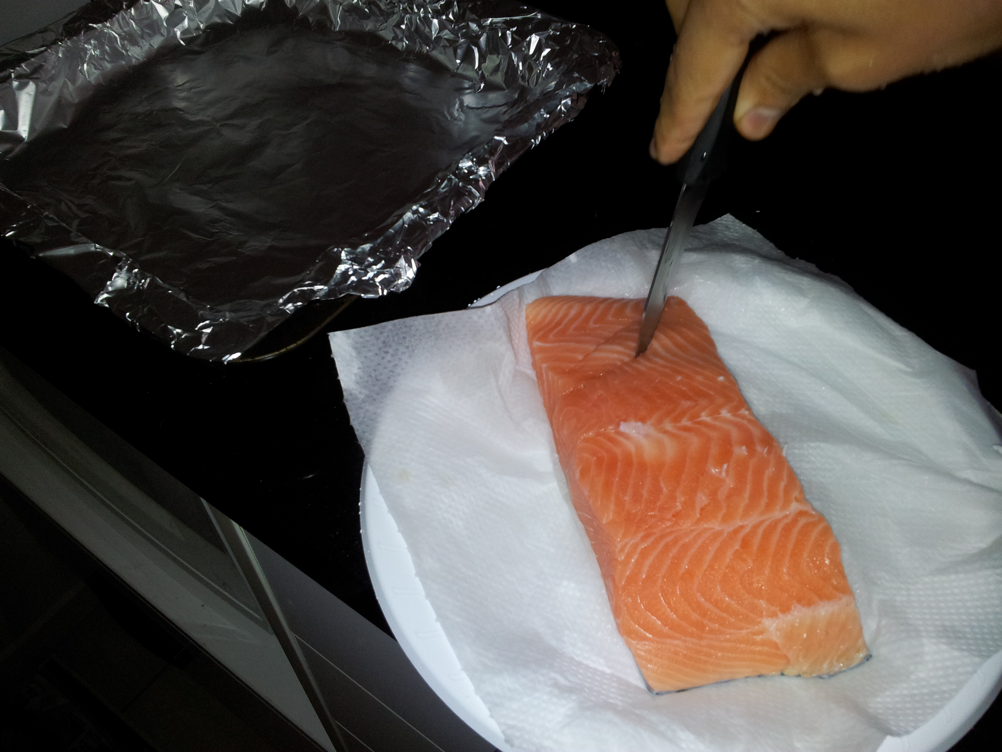 making slits opposite to the line on Salmon
